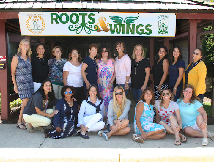 Group of preschool teachers and staff pose for a picture outside the school