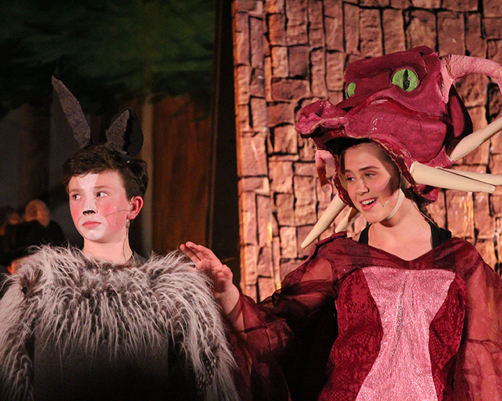 Donkey and Dragon in a scene from Shrek Jr.