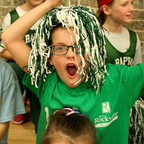 Student with pom-pons at spirit day