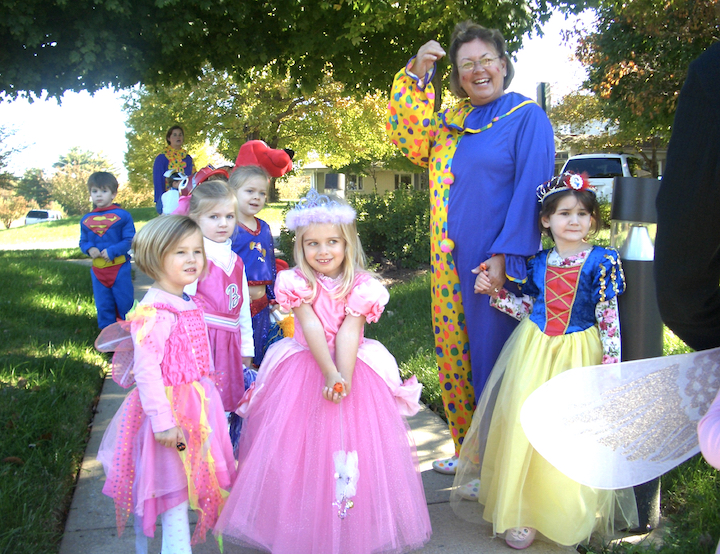 Teachers and students dressed in Halloween costumes