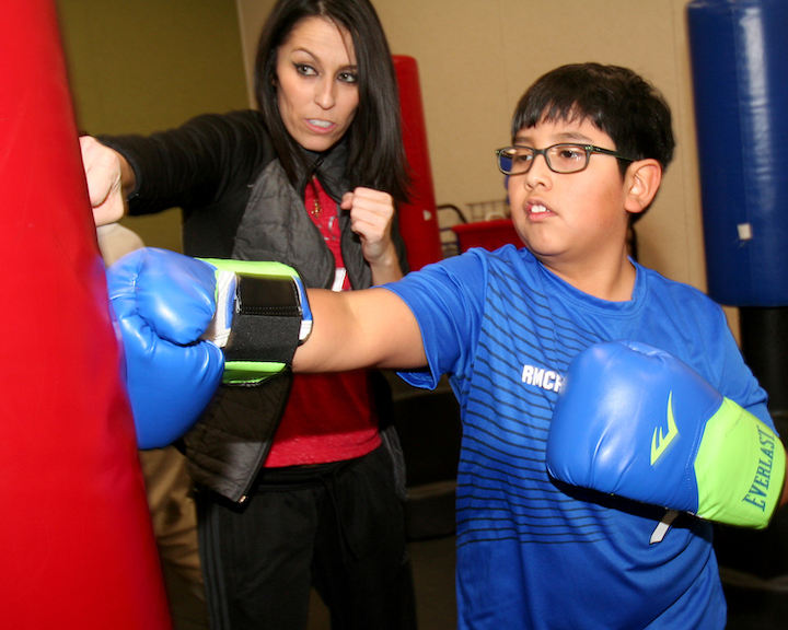 Student boxing with instructor
