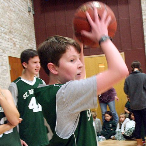 Student playing CYO basketball