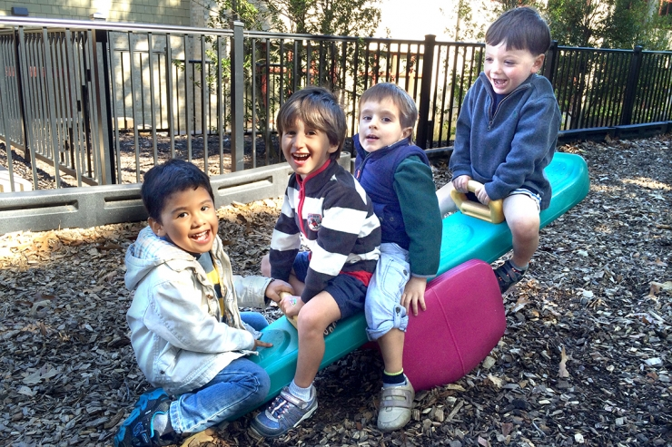 Four boys on teeter-totter