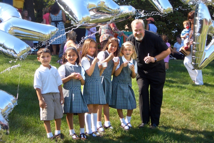 Fr. Bill and second-graders at Opening Day 2007