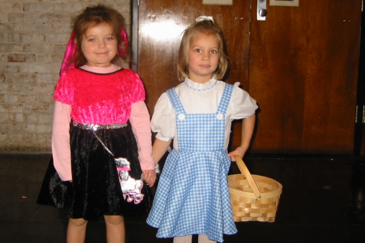 Two preschoolers in Halloween outfits
