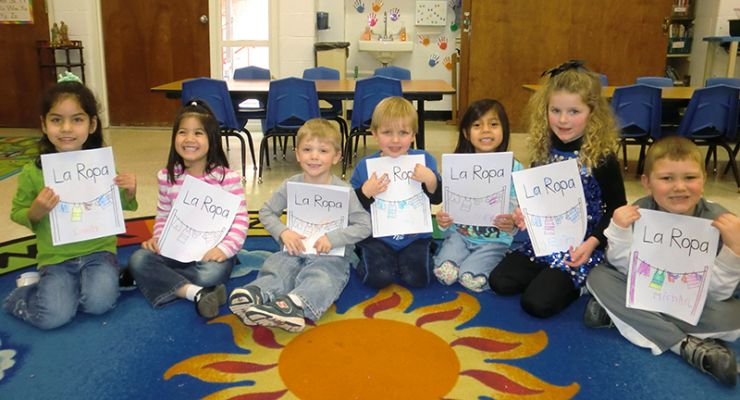 "Children holding ""la ropa"" pictures in Spanish Fiesta class"