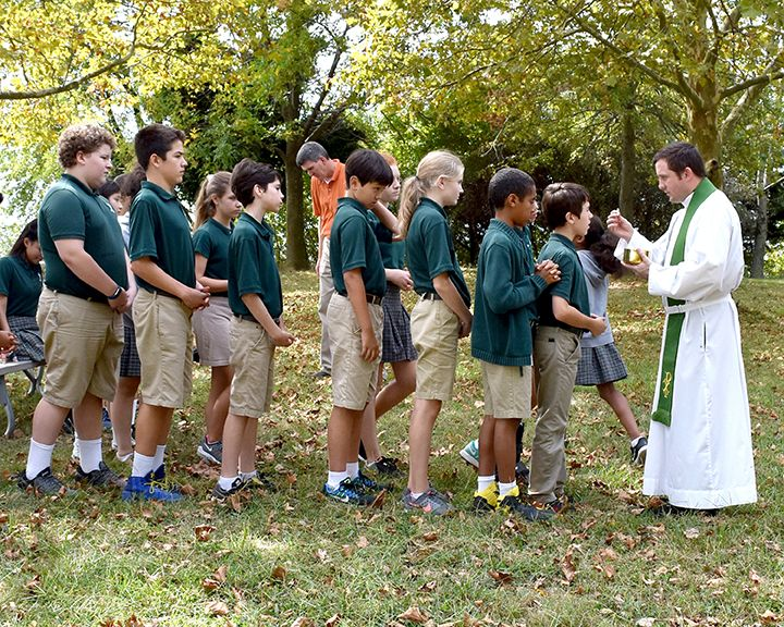 Seventh graders at outdoor Mass